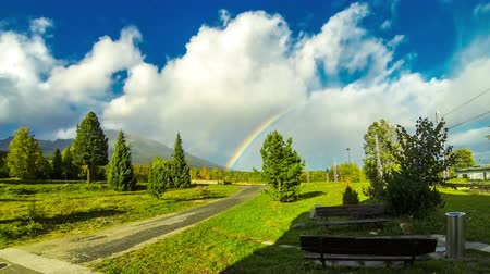 Beautiful rainbow over woods at Vysoke Tatry town in High Tatras mountains, Slovakia. Time Lapse. 4K UltraHD video