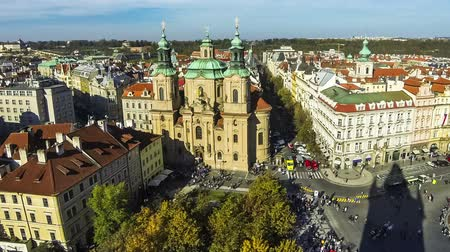 Aerial view of Saint Nicholas Church (Czech: Kostel Svateho Mikulase) and Old Town Square (Staromestske namesti) in Prague city, Czech Republic. Time Lapse. FullHD video