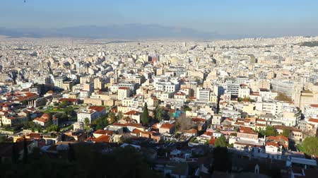 Panoramic aerial view of city of Athens, Attica, Greece. Skyline with mass of houses, buildings, apartments, rooftops in the city center of Greek capital. FullHD video
