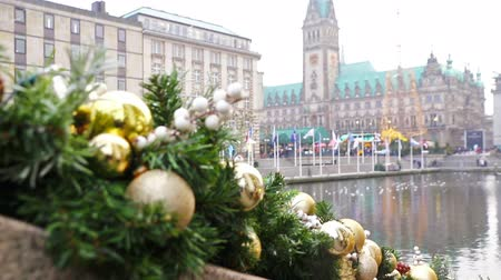 Winter view of Binnenalster lake and Christmas market at Town Hall square near Hamburg Town Hall (Hamburg Rathaus), Germany. Christmas decorations on a foreground. FullHD video Стоковые видеозаписи