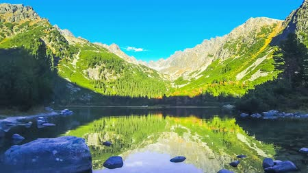 Picturesque view of Lake Popradske pleso in High Tatras, Slovakia. Sunny autumn day. Time Lapse. FullHD video