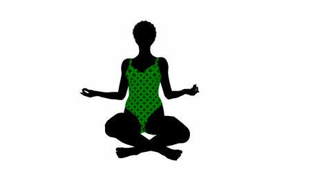 acrobata : African american female sitting in a yoga position on a white background Stock Footage