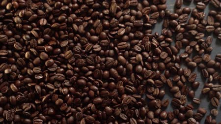 латте : Bouncing coffee beans Стоковые видеозаписи