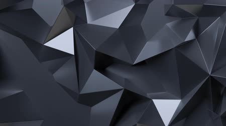 3d render black low poly graphite crystal abstract background. Seamlessly looping. Morphing 2k motion graphic videos