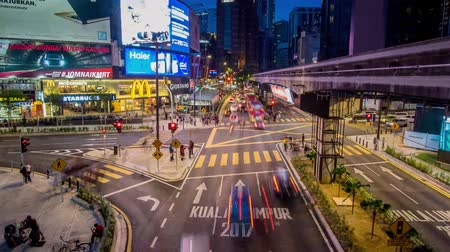 bintang : Kuala Lumpur, Malaysia - October 14 2017: Panning right view of transportation rush at night through the Bukit Bintang intersection in the Kuala Lumpur City Center