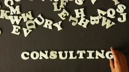 подготовке : A person spelling Consulting with plastic letters Стоковые видеозаписи