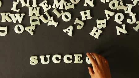 változás : A person spelling Success with plastic letters
