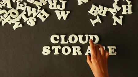 служба : A person spelling Cloud Storage with plastic letters Стоковые видеозаписи