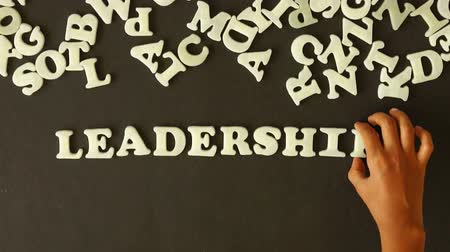 business values : A person spelling leadership