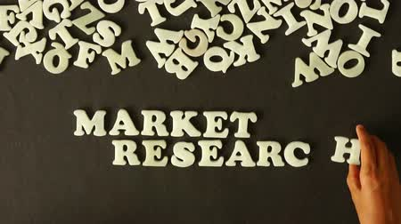 alphabet : A person spelling Market Research with plastic letters