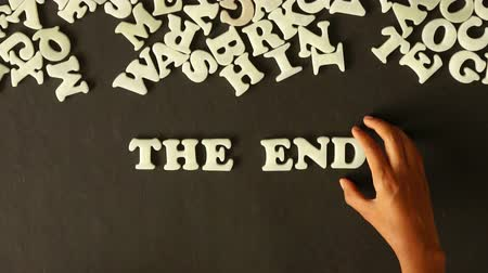 végre : A person spelling The End with plastic letters