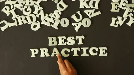 proces : A person spelling best Practice with plastic letters