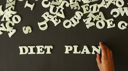 потеря : A person spelling Diet Plan with plastic letters Стоковые видеозаписи