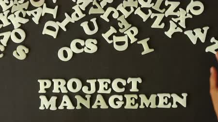 projects : A person spelling Project Management with plastic Letters