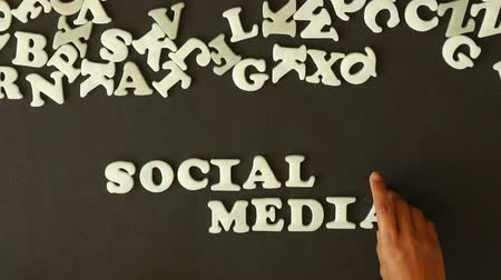 the media : A person spelling Social Media with plastic letters Stock Footage