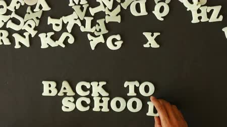 подготовке : A person spelling Back to School with Plastic Letters Стоковые видеозаписи