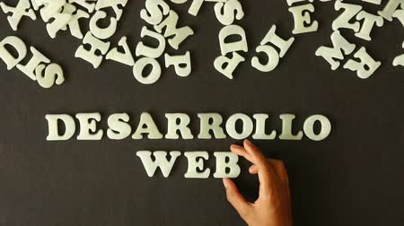 web sites : A person spelling Web development (In Spanish) with plastic letters Stock Footage