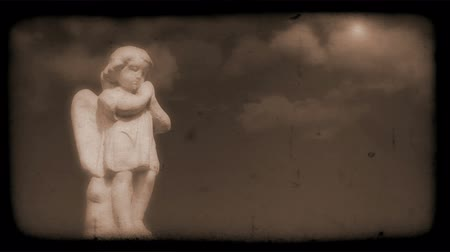 feltámadás : Vintage Film of Angel with Clouds moving in the background