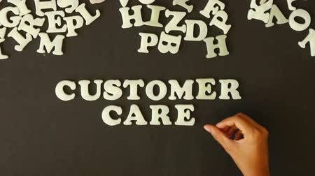 saygı : A person spelling Customer Care with Plastic Letters Stok Video