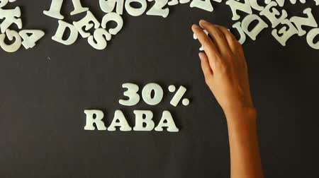 barganha : A person spelling 30 percent Discount with Plastic letters (In German)