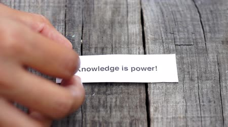 znalost : A Knowledge is Power paper sign on wood background