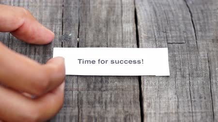 prim : A Time for success paper sign on wood background