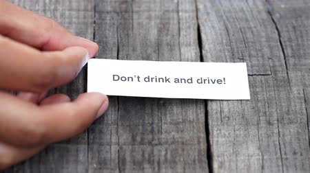 dui : A Dont drink and drive paper sign on wood background Stock Footage