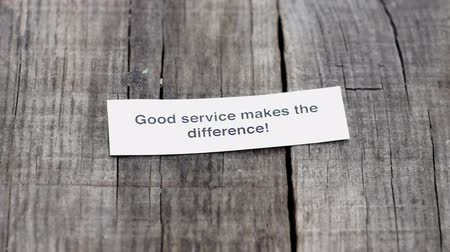 business values : A Good Service makes the difference  paper sign on wood background