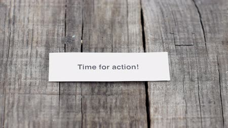 motivasyonel : A Time for action paper sign on wood background