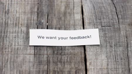 clientes : A We want your feedback paper sign on wood background
