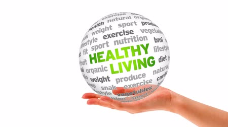 диета : A person holding a 3D Healthy Living Sphere Стоковые видеозаписи