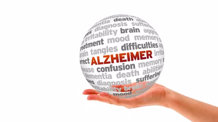 idade média : A person holding a 3d Alzheimer word Sphere Stock Footage