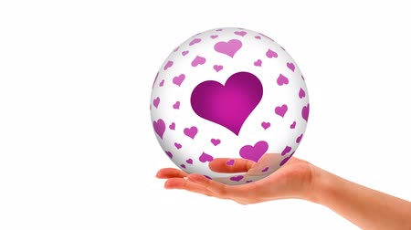 namiętność : A person holding a 3d sphere with Pink hearts Wideo