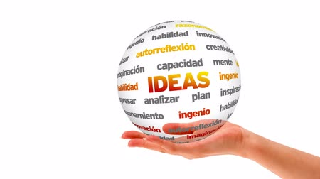 inventing : A person holding a 3d Ideas word sphere (In Spanish) Stock Footage