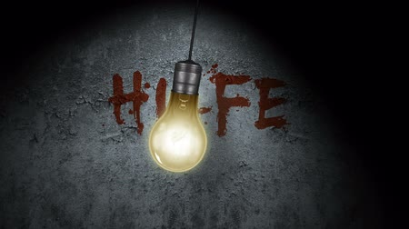 temor : A swinging light bulb with Please Help written in blood behind it on the wall (In German) Stock Footage