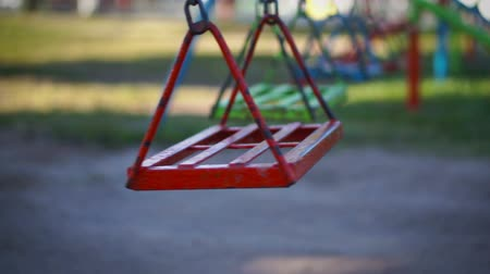 chains : Empty swing in a childrens playground