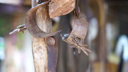 fegyelem : A dolly shot of Cowboy boot spurs