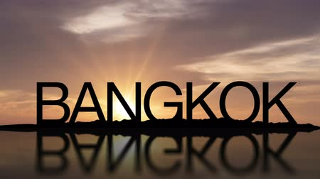 A sunset timelapse with the word Bangkok, Thailand reflecting in the water
