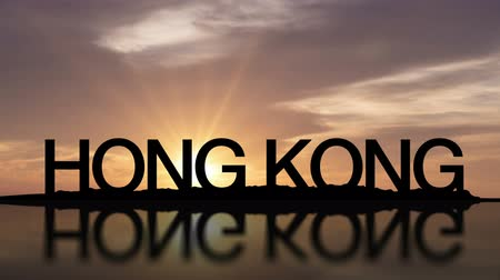 A sunset timelapse with the word Hong Kong, China reflecting in the water Wideo