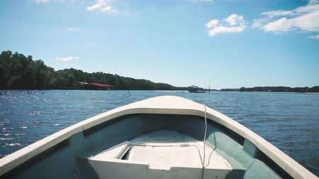 Ships bow, moving through the waves. Boat sailing on sea. Outdoor at the daytime with bright sunlight on summer day. Stok Video