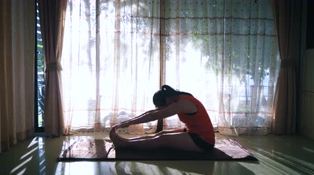 aerobic : Beautiful young asian woman practicing yoga at home. home interior background near floor window. Wideo