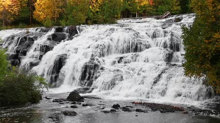 upper peninsula : Water cascades down the rock face of Bond Falls, a beautiful waterfall in Michigan