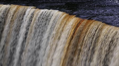 upper peninsula : Loop features water plunging over the brink of Tahquamenon Falls, a waterfall in Michigan Stock Footage