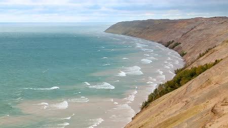 pictured : Looping video features waves breaking on the Lake Superior Coast of Upper Peninsula Michigan along Grand Sable Dunes, a stretch of tall sand dunes near the town of Grand Marais in Pictured Rocks National Lakeshore.