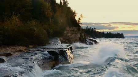pictured : Looping video features waves crashing hard on the rocky Lake Superior Coast of Upper Peninsula Michigan near Pictured Rocks National Lakeshore and the communities of Munising and Christmas. Stock Footage