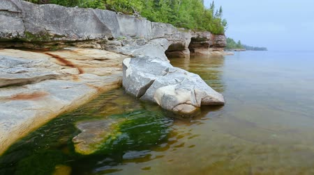 upper peninsula : Loop features a rocky, Upper Peninsula Michigan coastline on Lake Superior near Munising. Stock Footage