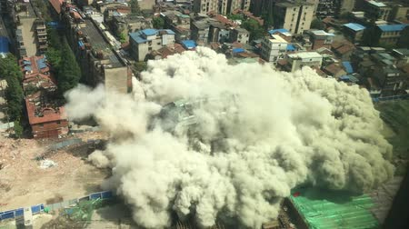 blocks of flats : Downtown building demolition by controlled implosion in China