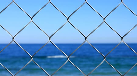 ferreous : Closed beach, focus on steel netting