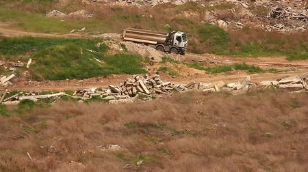 ferreous : Truck is driving along construction dump Stock Footage