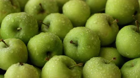 Fresh green apples sprayed with water